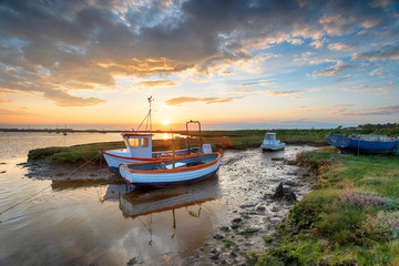 Stunning sunset over old fishing boats