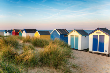 Wall Mural - Brightly coloured beach huts at Southwold