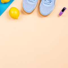 Fitness equipment. Woman workout accessories and clothes lay out. Top view, fitness background
