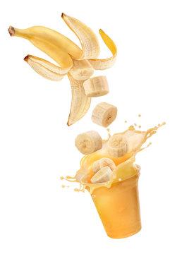 banana juice with a splash and bananas on a white background