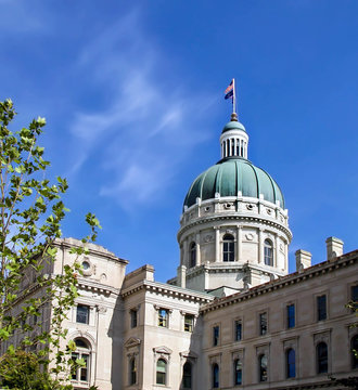Indianapolis state capitol building on a clear bright blue sky day.