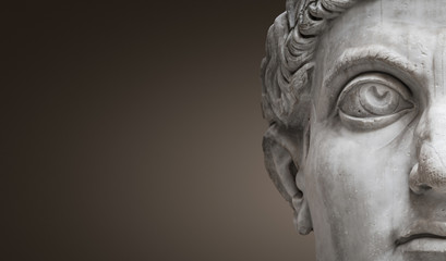Statue of Roman Nobel Man, his face at closeup, isolated at smooth gradient background, Rome