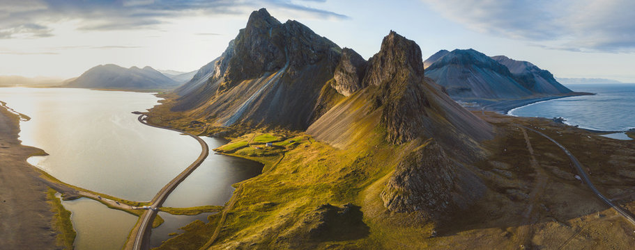 scenic road in Iceland, beautiful nature landscape aerial panorama, mountains and coast at sunset