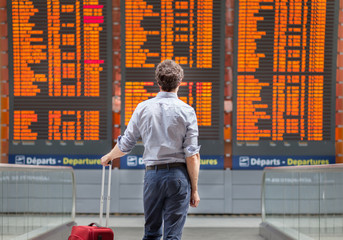 travel with international flight, person passenger waiting in airport departure terminal