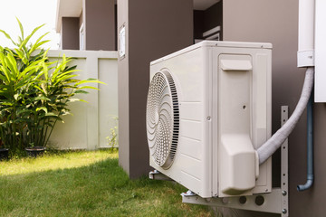 Fototapeta Air conditioner compressor outdoor unit installed outside the house obraz