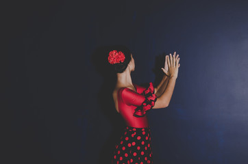 woman in red dress dancing spanish flamenco