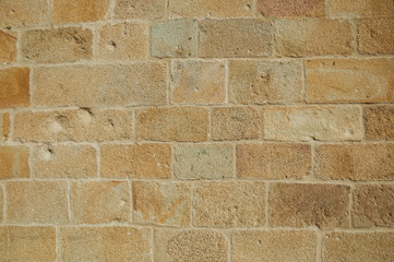 Close-up of wall with small gravel inserted into the plaster at Caceres
