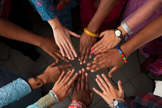 Hands of happy group of African people which stay together in circle