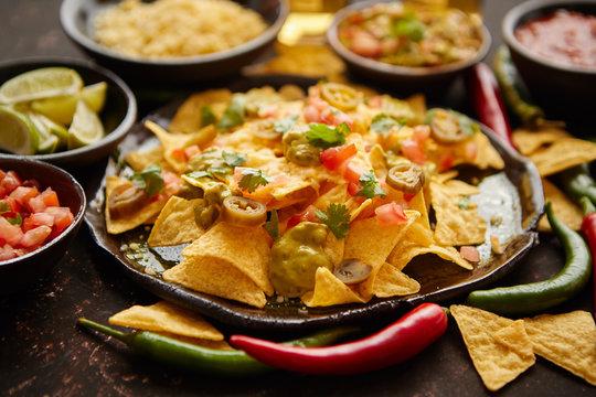 Fresh yellow corn nacho chips on ceramic plate