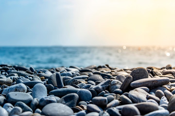 Sea stones and waves on the beach. Summer background.