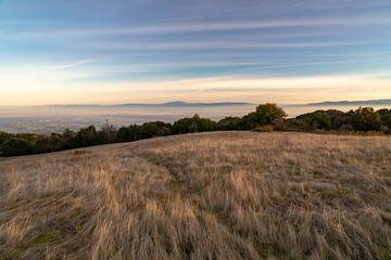 Sunset on silicon valley as seen from the top of Monte Bello open space above Palo Alto, California