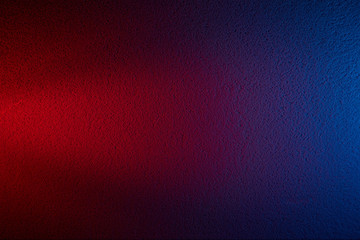 On a dark blue and dark red textural background a light red beam of light