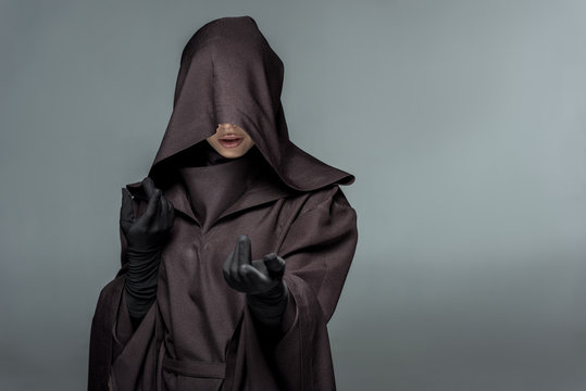 front view of woman in death costume gesturing isolated on grey