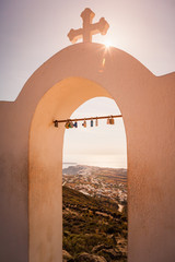 View of Oia through the bell tower of Panagia Church, Santorini, Greece