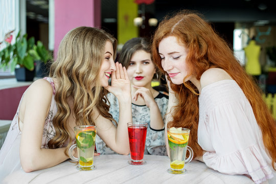 Beautiful girls gossip about their colleague. The concept of lifestyle, gossip, lies, friendship