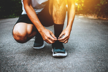 Man tied in shoes Running And go jogging,Sport Running