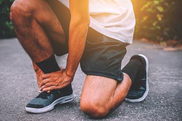 Fototapeta Runners injured on the ankle while running obraz
