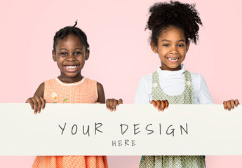 Two Young Girls Holding Banner Mockup