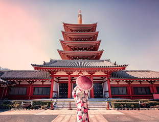 Girl with traditional dress in Senso-ji temple in Asakusa, Tokyo