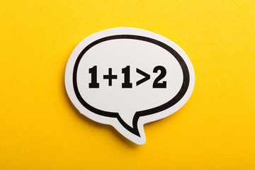 Synergy 1+1>2 Speech Bubble Isolated On Yellow Background