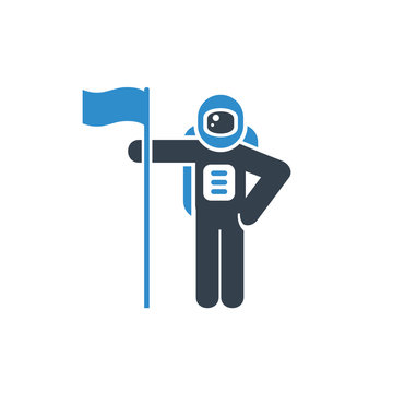 astronaut standing and holding a flag