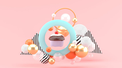 The cupcakes are in the center of the circle among the colorful balls on the pink background.-3d rendering.