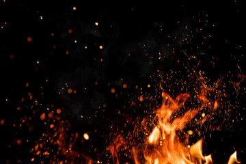 Photo sur Aluminium Feu, Flamme Detail of fire sparks isolated on black background