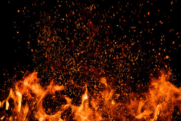 Photo sur cadre textile Feu, Flamme Detail of fire sparks isolated on black background