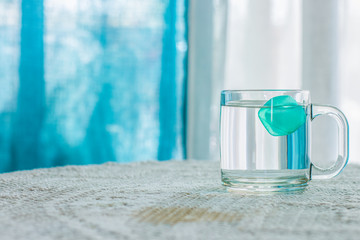 cup of water with ice bright interior environment creative and beautiful aquamarine and white colors composition wallpaper pattern with empty space for copy or text