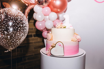 photo of a birthday party with cake and balls