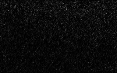 Falling raindrops isolated on dark background. Heavy rain and weather storm in raining season.