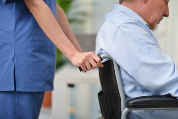 Nurse pushing a wheelchair