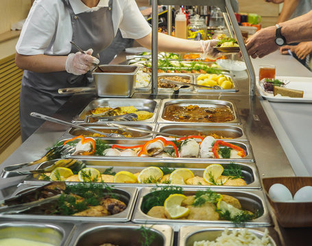 Cuisine cafeteria buffet with food. Self-service food display showcase