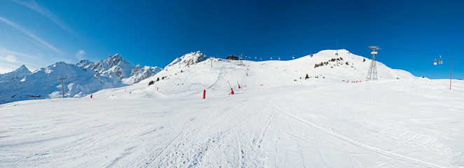 Wall Mural - View up a piste in alpine ski resort