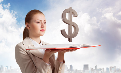 Woman with dollar sign above opened notebook