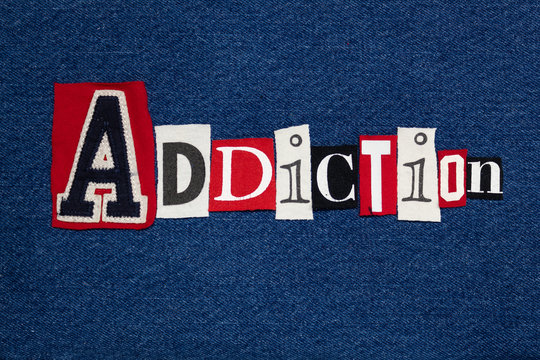 ADDICTION text word collage, colorful fabric on blue denim, health and addiction concept, horizontal aspect