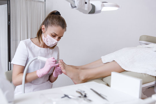 the master of a beauty salon does the pedicure client. Cleans the cuticles of the toenails
