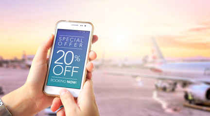 20 Off. Traveler girl in the airport holding a smartphone in her hands with a 20% discount advertising on the screen. Special Offer. Booking now. Marketing, ecommerce, cell phone publicity.