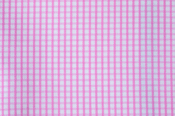 The texture of the tablecloth of pink pictures on the table in the snack.