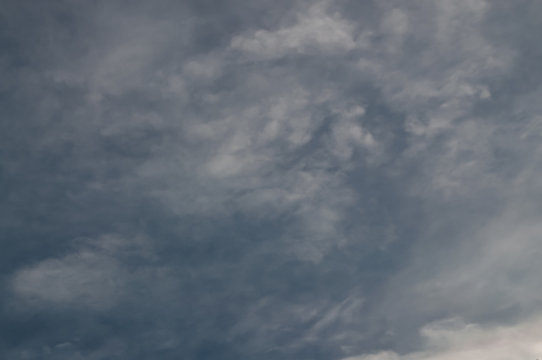 dark cloud swirling before rain.