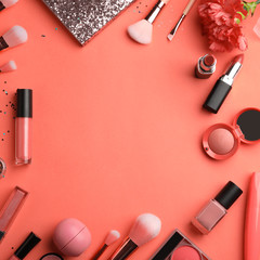 Flat lay composition with beauty accessories and space for text on coral background