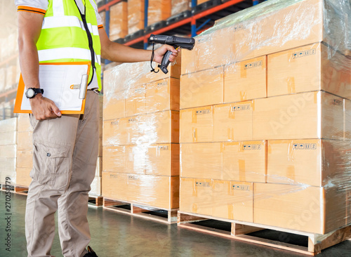 warehouse inventory management  warehouse worker is scanning