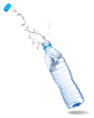 Water splash out of bottle isolated on white background.