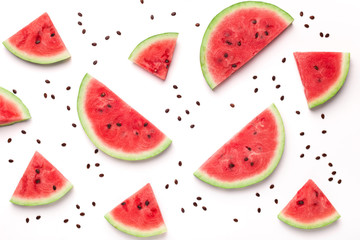 Sliced watermelon and seeds on white background