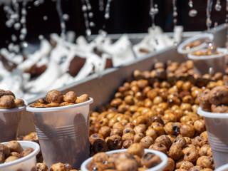 Tigernuts stall at a flea market, watered to keep them fresh