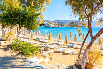 Fototapete - Umbrellas and chairs on beautiful Amopi beach, Karpathos island, Greece