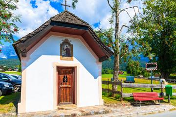 Wall Mural - Small chapel along road in Going am Wilden Kaiser village on beautiful sunny summer day, Tirol, Austria