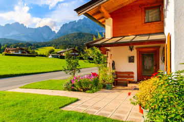 Wall Mural - Traditional alpine house in village of Going am Wilden Kaiser on beautiful sunny summer day, Tirol, Austria