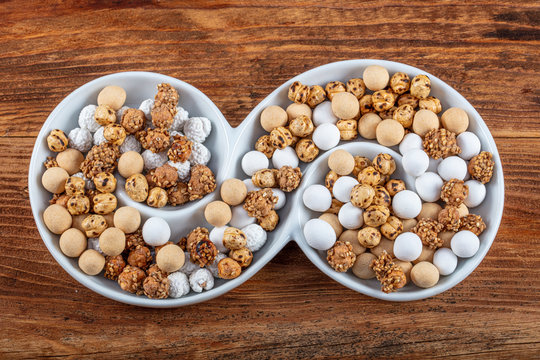Chickpeas on wooden background. The Turkish name is leblebi.
