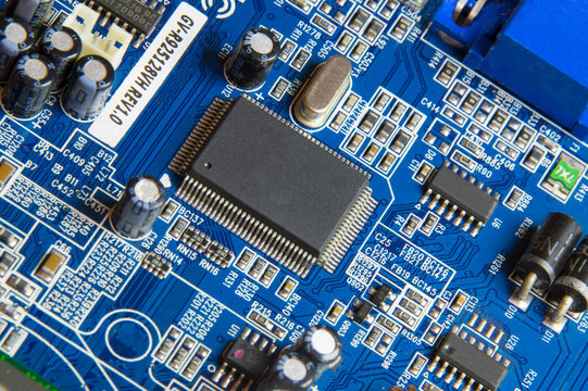 blue computer video board with a processor, microcontroller, smd circuit